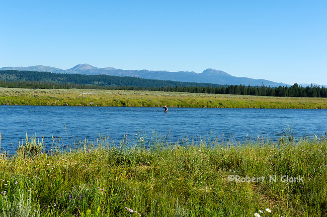 Fly Fisherman fishing the Henry's Fork of the Snake River near Last Chance, Idaho