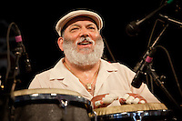 Latin jazz band leader, conga player and salsa singer Poncho Sanchez performing on the WWOZ Jazz Tent stage at the New Orleans Jazz and Heritage Festival at the New Orleans Fair Grounds Race Course in New Orleans, Louisiana, USA, 1 May 2009.