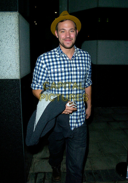 WILL YOUNG.The Sandra Bernhard VIP press night, Shaw Theatre, Euston Road, London, England..October 25th, 2007.full 3/4 length brown checkered shirt hat brown stubble facial hair jeans denim profile .CAP/CAN.©Can Nguyen/Capital Pictures