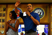 United States President Barack Obama and first lady Michelle Obama make their annual trip to greet current and retired members of the U.S. military and their families as they eat a Christmas Day meal in the Anderson Hall mess hall at Marine Corps Base Hawaii at Kaneohe Bay in Kaneohe, Hawaii, USA, on 25 December 2013. <br /> Credit: Kent Nishimura / Pool via CNP