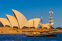 The Southern Swan (a tall ship) sailing in front of the Sydney Opera House, Sydney Harbor, Sydney, New South Wales, Australia