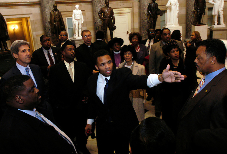Rep. Jesse Jackson (C), Jr., D-Il., and Sen. John Kerry, D-Ma., give a tour to Rev. Jesse Jackson, and friends and supporters of Rosa Parks in Statuary Hall of the Capitol, where a statue of the civil rights leader is to be placed by 2007.