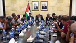 Palestinian Prime Minister Mohammed Ishtayeh receives the events of Al Ain, Balata and Kufr Aqab camps, in the West Bank city of Ramallah, on August 24, 2019. Photo by Prime Minister Office
