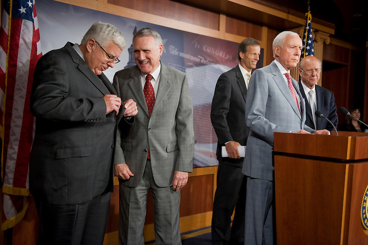 UNITED STATES - JUNE 30:  From left, Sen. Mike Enzi, R-Wyo., Senate Minority Whip Jon Kyl, R-Ariz., Sens. John Thune, R-S.D., Orrin Hatch, R-Utah, and Pat Roberts, R-Kan., prepare for a news conference on their objections to the timing of a Senate Finance Committee markup of three trade agreements. (Photo By Tom Williams/Roll Call)