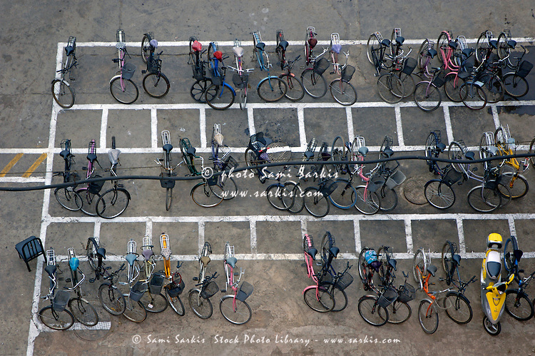 Bicycles parked in rows on a city street in Datong, Shanxi, China.