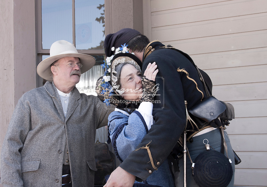 A Civil War Soldier saying goodbye to his parents reenactment
