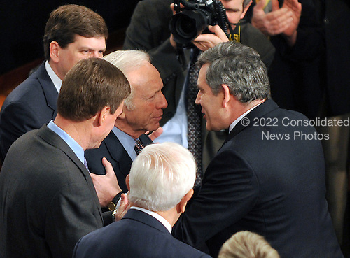 Washington, DC - March 4, 2009 -- Prime Minister Gordon Brown of the United Kingdom greets United States Senator Joseph Lieberman (Independent Democrat of Connecticut) as he arrives to address a Joint Session of the U.S. Congress in the U.S. Capitol in Washington, D.C. on Wednesday, March 4, 2009..Credit: Ron Sachs / CNP