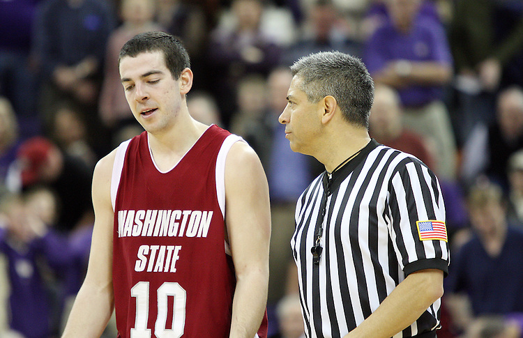 Taylor Rochestie, Washington State senior guard, confers with one of the referees during the Cougars Pac-10 conference showdown with the University of Washington on March 7, 2009, in Seattle, Washington.  Both teams came in to the game on a roll, and in a hard fought battle, the Huskies prevailed 67-60 to wrap up the regular season Pac-10 championship.