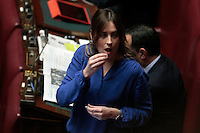 Elena Boschi mangia una caramella<br /> Roma 25-02-2014 Camera. Voto di fiducia al nuovo Governo.<br /> Senate. Trust vote for the new Government.<br /> Photo Samantha Zucchi Insidefoto