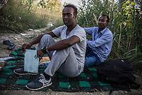 due migranti seduti. accampamento di migranti a Subotiza, nei pressi della vecchia fabbrica  camp for migrants in Subotiza , near the old factory