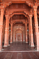 Fatehpur Sikri, Uttar Pradesh, India.  Mihrab (Niche indicating the direction of Mecca) and Prayer Hall of the Jama Masjid (Dargah Mosque).  Hindu arches in front, Islamic arches around the mihrab.
