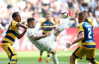 Calcio, Serie A: Inter Milano-Parma, Giuseppe Meazza stadium, September 15, 2018.<br /> Inter's Mauro Icardi (c) in action with Parma's Bruno Alves (l) and Simone Iacoponi (r) during the Italian Serie A football match between Inter and Parma at Giuseppe Meazza (San Siro) stadium, September 15, 2018.<br /> UPDATE IMAGES PRESS/Isabella Bonotto