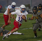 Reno quarterback #17 runs against Galena in their football game played on Friday night Sept. 16, 2016 at Galena High School.