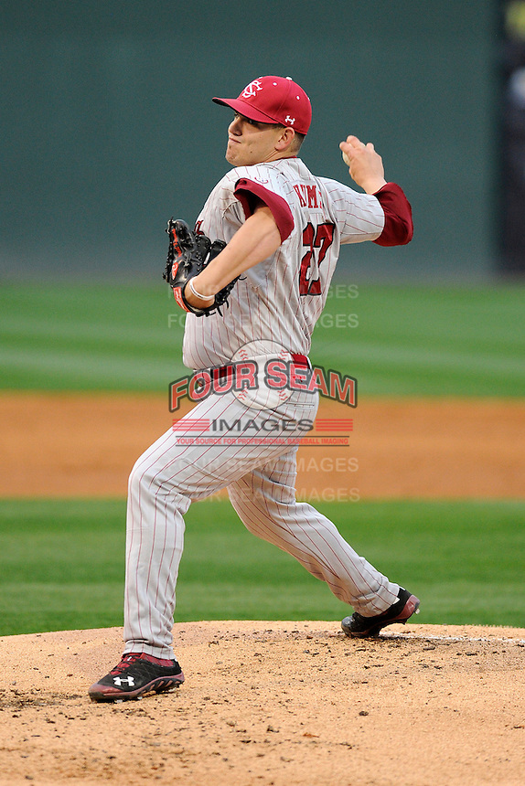 Starting pitcher Forrest Koumas (27) of the South Carolina Gamecocks throws in a game against the Furman Paladins on Wednesday, April 3, 2013, at Fluor Field at the West End in Greenville, South Carolina. (Tom Priddy/Four Seam Images)