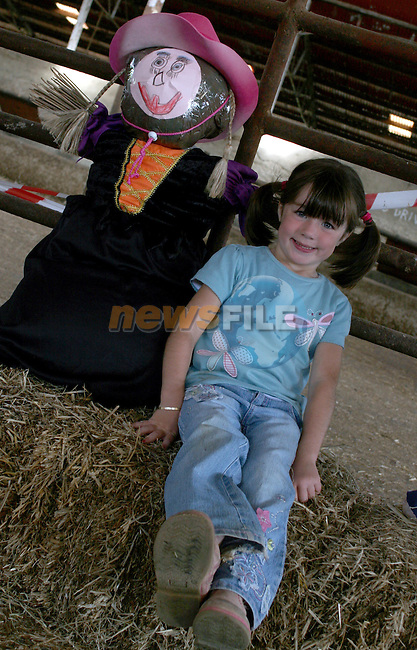 """Abby Doyle with """"Sally""""  at the Scarecrow Competition in Newgrange Farm...Photo NEWSFILE/Jenny Matthews.(Photo credit should read Jenny Matthews/NEWSFILE)....This Picture has been sent you under the condtions enclosed by:.Newsfile Ltd..The Studio,.Millmount Abbey,.Drogheda,.Co Meath..Ireland..Tel: +353(0)41-9871240.Fax: +353(0)41-9871260.GSM: +353(0)86-2500958.email: pictures@newsfile.ie.www.newsfile.ie.FTP: 193.120.102.198."""