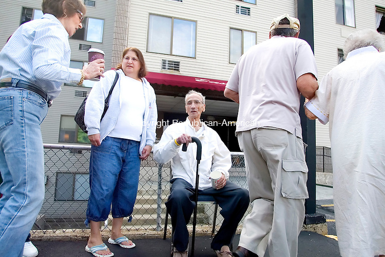 WATERBURY, CT. 11 SEPTEMBER 2008-091108SV04--John Zabbara sits outside East Gate Apartments with his daughter Judi Taylor as residents head back in after an early morning fire forced them out into the street at 2221 East Main Street in Waterbury Thursday. Steven Valenti Republican-American