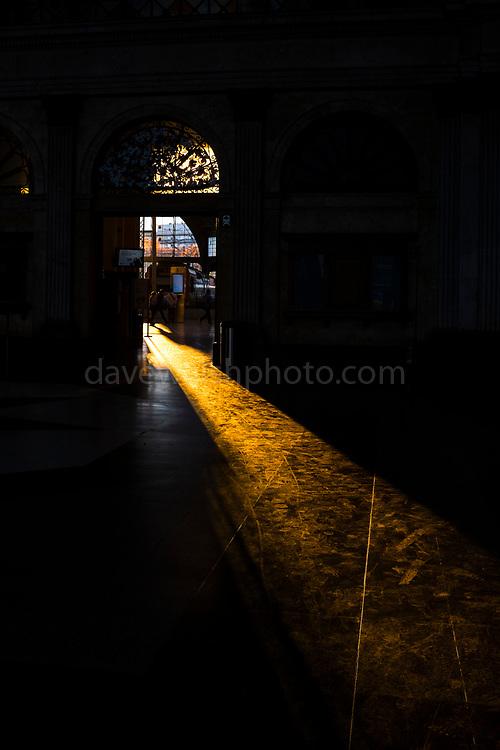 Long winter shadows fall in the entrance hall of Estació de França, railway station, Barcelona, December 2017.