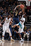 Cornelius Hudson (25) of the Wake Forest Demon Deacons tries to block the shot attempt of Cameron Wright (3) of the Pittsburgh Panthers during first half action at the LJVM Coliseum on March 1, 2015 in Winston-Salem, North Carolina.  The Demon Deacons defeated the Panthers 69-66.  (Brian Westerholt/Sports On Film)