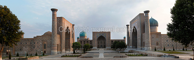 """Panoramic view of Registan Square, showing the Sher-Dor, 1619-36, (right), Tillya-Kori, 1646-60, (centre) and Ulugh Beg, 1417-20, (left) Madrasahs, Samarkand, Uzbekistan, pictured on July 16, 2010, at dawn. The Tillyah-Kori (gilded) Madrasah is part of the Registan Ensemble, surrounding a magnificent square. Commissioned by Yalangtush Bakhadur it is not only a school but also the grand mosque. The Sher-Dor Madrasah, commissioned by Yalangtush Bakhodur as part of the Registan ensemble, and designed by Abdujabor, takes its name, """"Having Tigers"""", from the double mosaic (restored in the 20th century) on the tympans of the portal arch showing suns and tigers attacking deer. The lancet arched portal of the Ulugh Beg Madradsah, commissioned by the scholarly Ulugh Beg, faces the square and high well-proportioned minarets flank the corners. It was restored in the early twentieth century. Samarkand, a city on the Silk Road, founded as Afrosiab in the 7th century BC, is a meeting point for the world's cultures. Its most important development was in the Timurid period, 14th to 15th centuries. Picture by Manuel Cohen."""