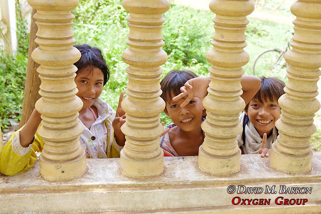 Young Local Children Greet Tourists At Choeung Ek