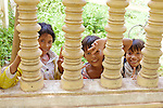 Young Local Children Greet Tourists At Choeung Ek