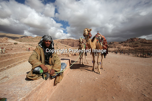 Bdoul bedouin Salman, waits for tourists to come for a camel ride to tour Petra, in south Jordan. (Salah Malkawi)
