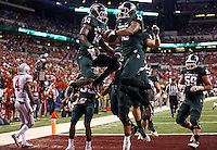 Michigan State Spartans wide receiver Bennie Fowler (13) congrulates teammate Michigan State Spartans wide receiver Tony Lippett (14) after Lippet scored a touchdown during the second quarter of the Big Ten championship football game at Lucas Oil Stadium in Indianapolis on Dec. 7, 2013. (Adam Cairns / The Columbus Dispatch)