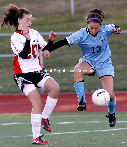 Southbury, CT- 22, October 2010-102210CM01 Oxford's Andrea Nuzzulo (#13) handles the ball as Pomperaug's Jamie Belden (#20)defends Thursday afternoon in Southbury.  Christopher Massa Republican-American