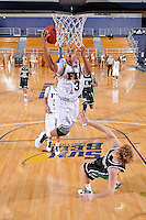 6 February 2010:  FIU's Tremayne Russell (3) shoots over North Texas' Collin Mangrum (20) in the second half as the North Texas Mean Green defeated the FIU Golden Panthers, 68-66, at the U.S. Century Bank Arena in Miami, Florida.