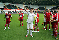 Pictured: Adam Woodyatt from Eastenders with the winning trophy after the end of the game. Sunday, 01 June 2014<br />