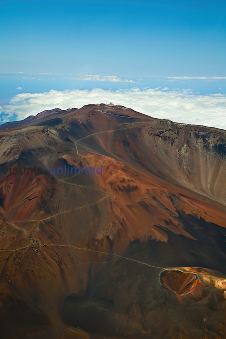 Aerial view across Sliding Sands Trail and Haleakala Crater toward Science City at the summit of the dormant volcano, Haleakala National Park, Maui, Hawaii, USA.