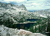 Baron Lake and Monte Verita Peak as seen from Baron divide. mountains and forest landscape dusted with snow, geography, mountain, wilderness. scenic, pristine. Idaho, Sawtooth National Recreation Area.