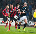 St Johnstone's Chris Millar and Dundee's Gary Harkins challenge for the ball.
