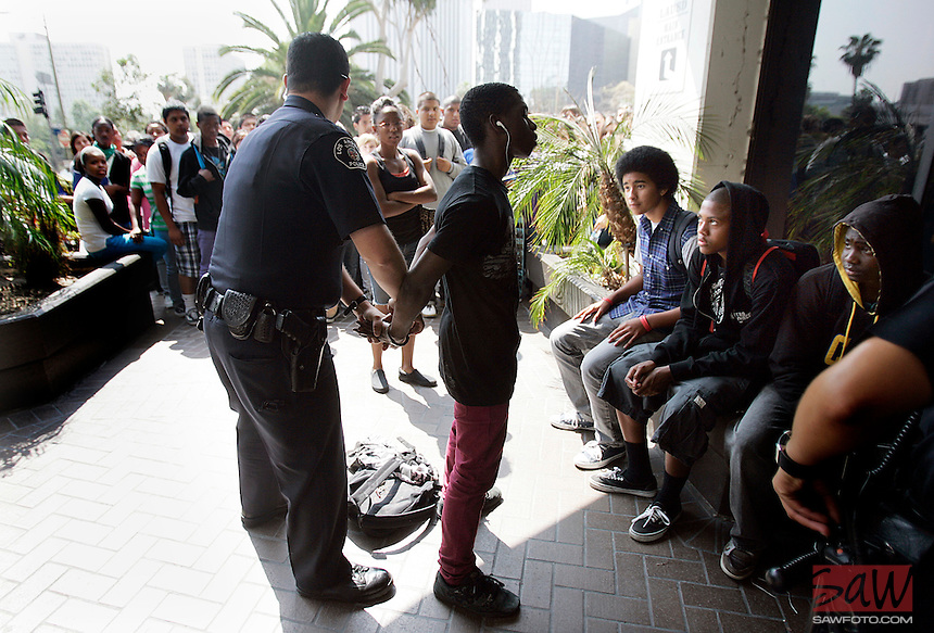 LOS ANGELES, CA. MAY 22, 2009: Several High School students were detained by police during a mostly peaceful protest, May 22, 2009 outside the the Los Angeles Unified School District's downtown headquarters to protest pending teacher layoffs.