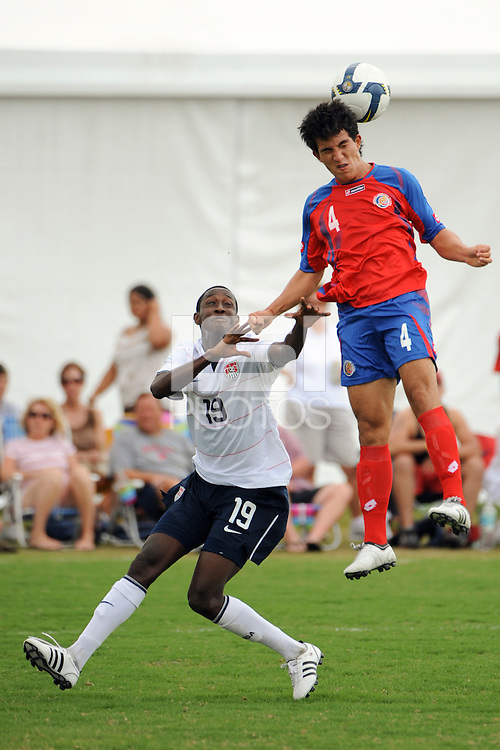 Juan Andres Monge (4) of Costa Rica heads the ball as Fuad Ibrahim (19) of the USA watches. The US U-20 Men's National Team defeated the U-20 Men's National Team of Costa Rica 2-1 in an international friendly during day four of the US Soccer Development Academy  Spring Showcase in Sarasota, FL, on May 25, 2009.