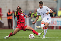 Billy Clifford of Crawley Town (18) (left) and Oliver Lee of Luton Town (19) (right) challenge for the ball  during the Sky Bet League 2 match between Crawley Town and Luton Town at the Broadfield/Checkatrade.com Stadium, Crawley, England on 17 September 2016. Photo by Edward Thomas / PRiME Media Images.