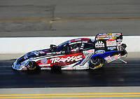 Apr. 13, 2012; Concord, NC, USA: NHRA funny car driver Courtney Force during qualifying for the Four Wide Nationals at zMax Dragway. Mandatory Credit: Mark J. Rebilas-