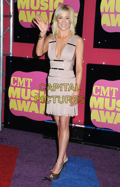 Kellie Pickler.2012 CMT Music Awards held at Bridgestone Arena, Nashville, Tennessee, USA..June 6th, 2012.full length beige pink dress hand arm waving low cut neckline cleavage .CAP/ADM/LF.©Laura Farr/AdMedia/Capital Pictures.