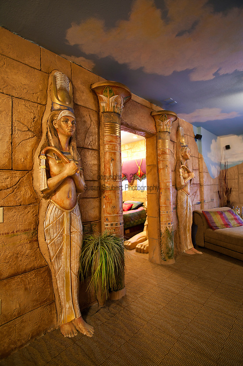 """The Victorian exterior of the Anniversary Inn gives no hint of the over-the-top decor inside.  Room themes include """"Sultans Palace"""" and """"Mysteries of Egypt"""" pictured here.  This room includes a lounge and queen-sized bed, a jetted tub and other amenities."""
