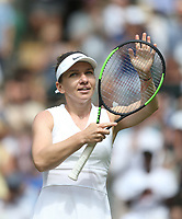 Simona Halep (ROU) celebrates after winning her match against Aliaksandra Sasnovich (BLR) in their Ladies' Singles First Round match<br /> <br /> Photographer Rob Newell/CameraSport<br /> <br /> Wimbledon Lawn Tennis Championships - Day 1 - Monday 1st July 2019 -  All England Lawn Tennis and Croquet Club - Wimbledon - London - England<br /> <br /> World Copyright © 2019 CameraSport. All rights reserved. 43 Linden Ave. Countesthorpe. Leicester. England. LE8 5PG - Tel: +44 (0) 116 277 4147 - admin@camerasport.com - www.camerasport.com