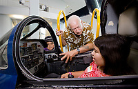 Rollen McKinney, center, talks with his grandchildren about a Blue Angel cockpit trainer at the National Naval Aviation Museum.<br /> <br /> COLIN HACKLEY PHOTO