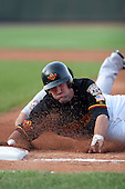 August 12 2008:  Jason Pridie (11) of the Rochester Red Wings, Class-AAA affiliate of the Minnesota Twins, tries to get back to first when tagged out by Danny Sandoval of the Syracuse Chiefs during a game at Frontier Field in Rochester, NY.  Photo by:  Mike Janes/Four Seam Images