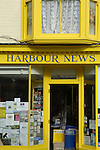 Colourful shop front with Harbour News sign in Whitstable, Kent