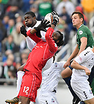 Colorado Springs goalkeeper Ceus Steward (center,12) reaches for an incoming corner kick, but the ball bounced away from goal. Also shown are Colorado Springs teammate Jack Jamal (left, 8) and St. Louis FC defender Sam Fink (right). The St. Louis FC soccer team hosted the Colorado Springs Switchbacks in their home opener on Saturday March 31 at Toyota Stadium in Fenton. St. Louis won, 1-0.<br />Photo by Tim Vizer