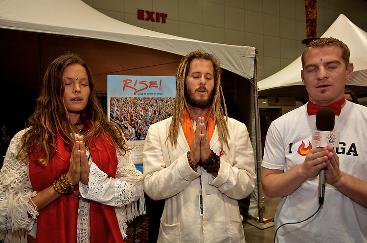 Global Mala Project (GMP) event.  Press.  Govindas and Radha with a TV reporter chanting OM.