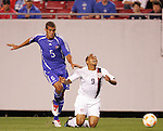 11 March 2008: Charlie Davies (USA) (9) is brought down by Yendry Diaz (CUB) (5). The United States U-23 Men's National Team tied the Cuba U-23 Men's National Team 1-1 at Raymond James Stadium in Tampa, FL in a Group A game during the 2008 CONCACAF's Men's Olympic Qualifying Tournament.
