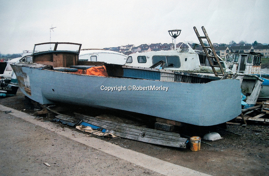 BNPS.co.uk (01202 558833)<br /> Pic: RobertMorley/BNPS.<br /> <br /> Taking shape - DCB 1 being reconstructed in Roberts yard.<br /> <br /> The world's first drone boat is rediscovered - after 100 years in the shadows.<br /> <br /> A historic British torpedo boat, which was converted into the world's first remotely controlled 'drone vessel' as part of a top secret project at the end of the Great War has been painstakingly researched and restored after being discovered rotting in a West country boatyard.<br /> <br /> The pioneering CMB9/DCB1 was one of 12 Coastal Motor Boats (CMBs) built by the Admiralty in 1916 to target German destroyers.<br /> <br /> The fast, lightweight 40ft motor torpedo boat, which could travel at 40 knots, sunk the German destroyer G88 off Zebrugge in Belgium in 1917.<br /> <br /> Subsequently, it was one of four vessels converted into Distance Control Boats (DCBs) for top secret trials to see if unmanned patrol boats with torpedoes could be radio controlled via aircraft and directed towards enemy targets.<br /> <br /> The boat was found in a sorry state covered in brambles in a boat yard in Weston-super-Mare, Somerset, by marine surveyor Robert Morley a decade ago, who has spent tens of thousands of pounds restoring and researching it's colourful history.
