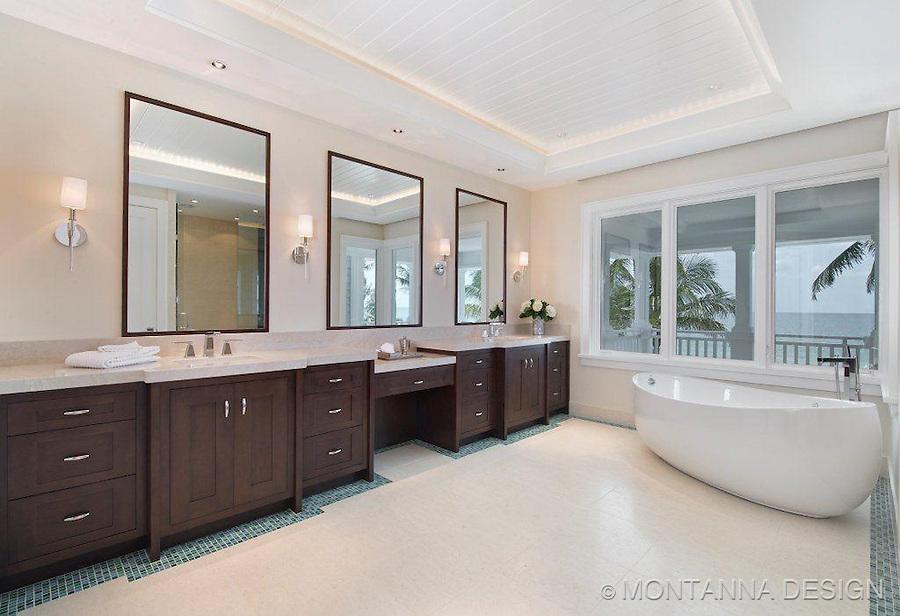Beach house modern master bath with dual vanities and soaking tub.