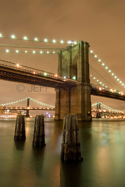 AVAILABLE FROM JEFF AS A FINE ART PRINT<br /> <br /> AVAILABLE FROM CORBIS FOR COMMERCIAL AND EDITORIAL LICENSING.  Please go to www.corbis.com and search for image # 42-20926626.<br /> <br /> Brooklyn Bridge and East River Illuminated at Night, New York City, New York State, USA..
