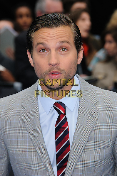 Logan Marshall-Green.'Prometheus' film premiere held at the Empire Leicester Square, .London, England , UK, 31st May 2012..portrait headshot  grey gray suit stubble facial hair red blue navy striped tie .CAP/CJ.©Chris Joseph/Capital Pictures.